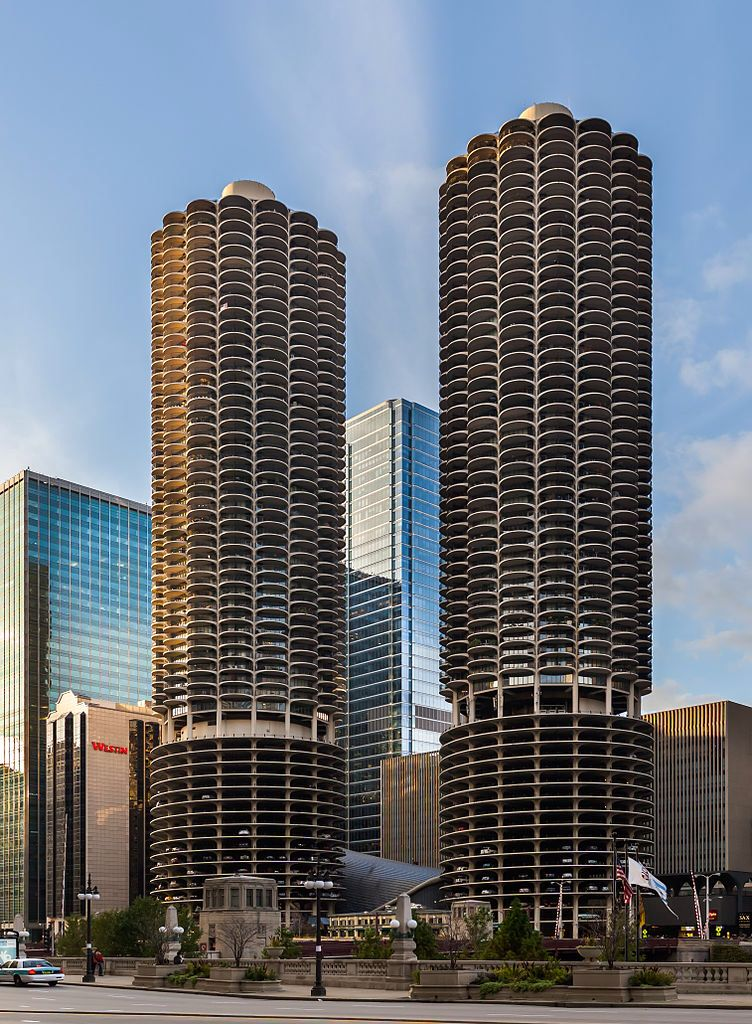Marina City is a mix-use residential/commercial building complex located in de centre of Chicago, Illinois_ USA. It sits on de north bank of de Chicago River directly across from de Loop District. De complex, was designed in 1959 n completed in 1964, consists of two corncob-shaped 179 m, 65 story-towers.