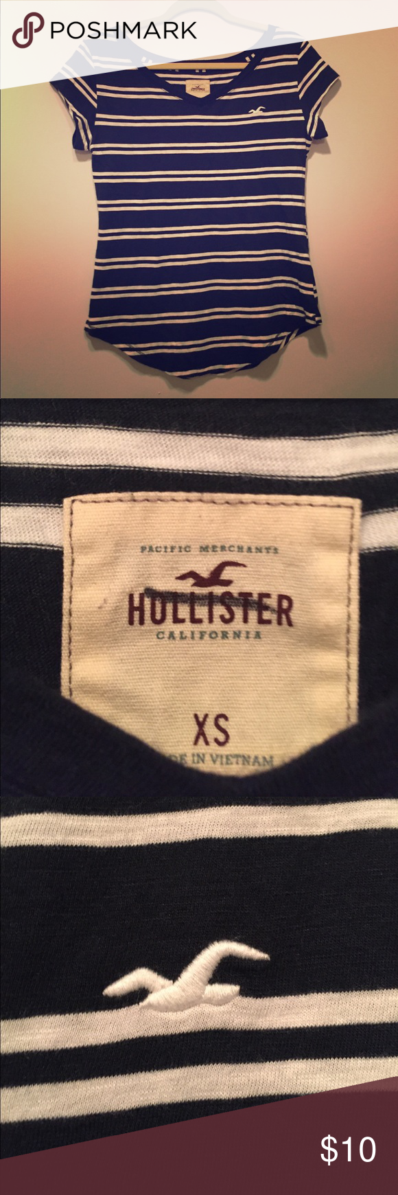 "Hollister Blue and White Striped T-shirt NWOT Hollister blue and white striped t-shirt. The shirt has a wide V-neck and the bottom of the shirt is ""U"" shaped in both the front and back. The material is very soft and if high quality. The shirt has. Ever been worn and is in perfect condition.  NWOT Hollister Tops Tees - Short Sleeve"
