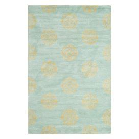 Hand-tufted wool rug in turquoise with a medallion motif.    Product: RugConstruction Material: WoolColor: TurquoiseFeatures:  Made in IndiaHand-tufted Note: Please be aware that actual colors may vary from those shown on your screen. Accent rugs may also not show the entire pattern that the corresponding area rugs have.Cleaning and Care: Professional cleaning recommended