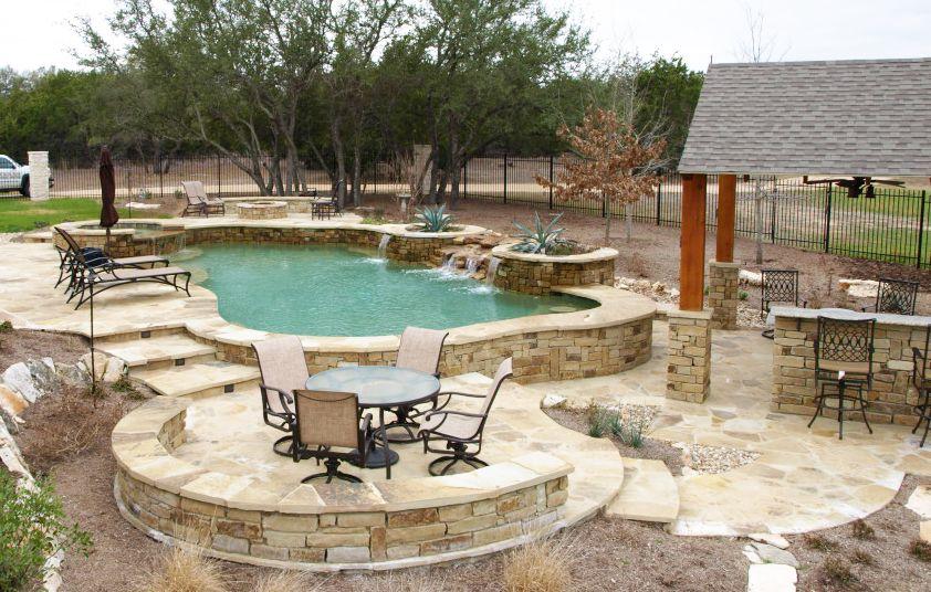 Austin Outdoor Living Photos Outdoor Kitchens Fireplaces San Antonio Freeform Pool With Raised Spa S Outdoor Living Living Photo Pool Builders