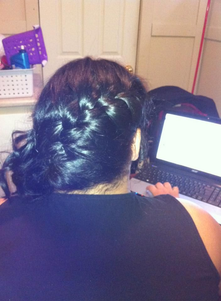 A french braid starting at the parietal ridge and going on a diagnol line to the oppisite side to the nape, then let losely and curl with a flat iron, curling iron, or a wand.