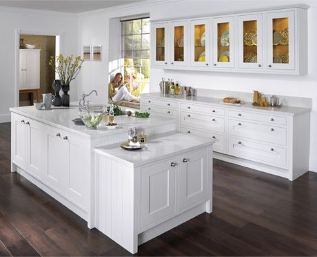 white gives a clean, fresh look to the cabinetry and countertops. Love the dark wood contrast.