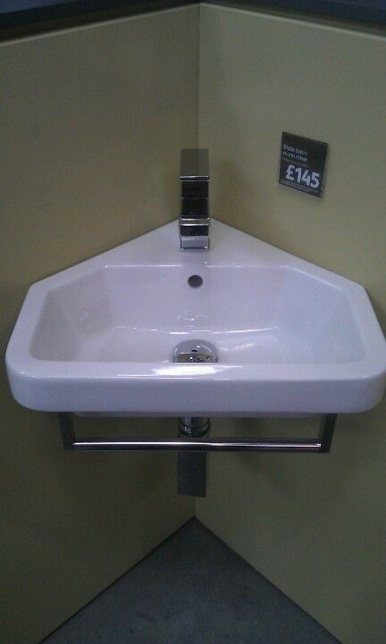 Corner sink with cubist taps and trap Inc towel rail