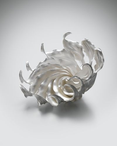 """Spiritus"" by Theresa Nguyen, 2010 Fold-formed, hammered and soldered ... a conceptual vessel for aesthetic effect. She has interpreted the notion of containment by producing an open and fluid form composed of multiple leaves unfurling from a tightly packed core."