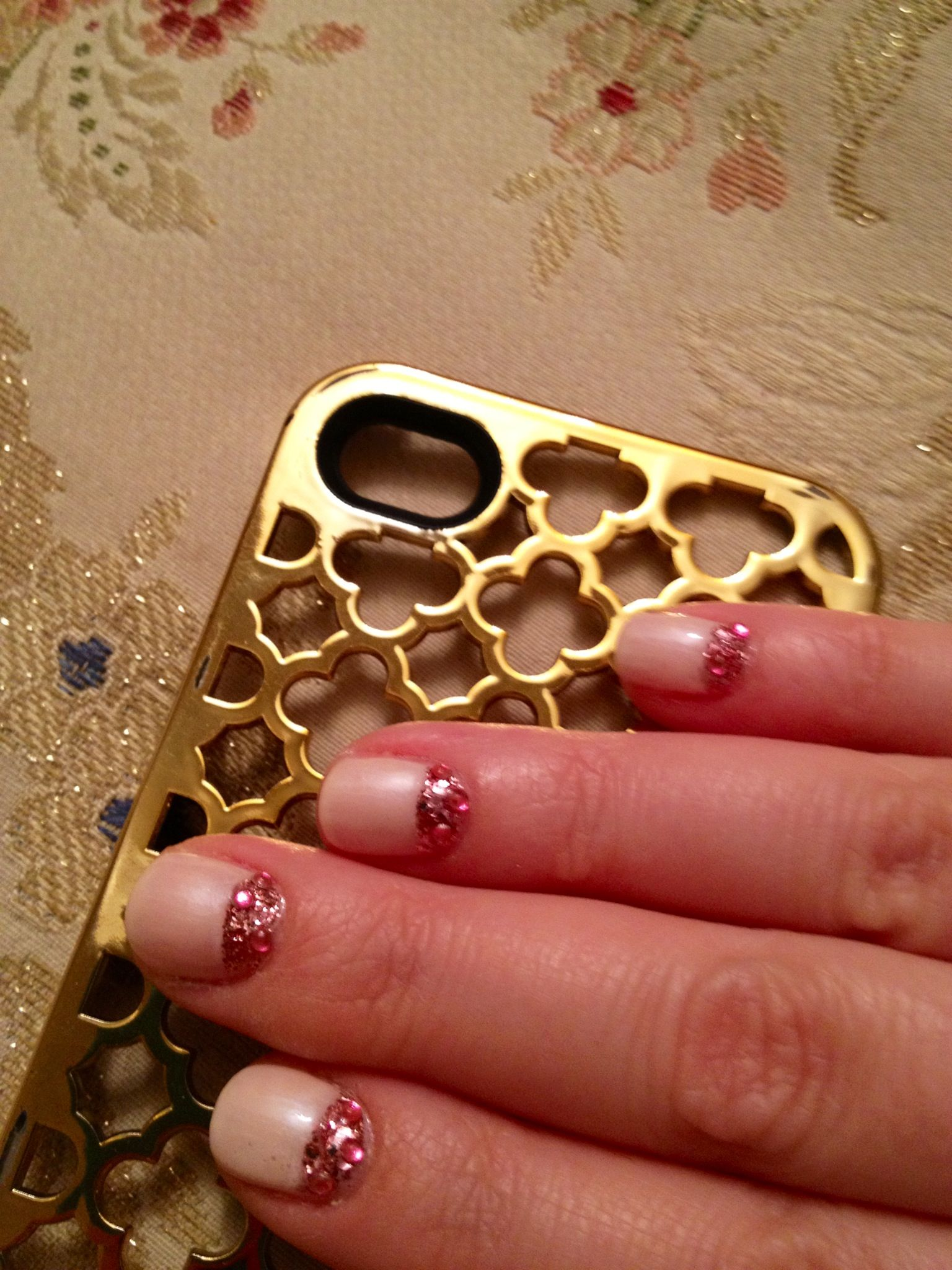 Pink half moon nails with glitter and rhinestones