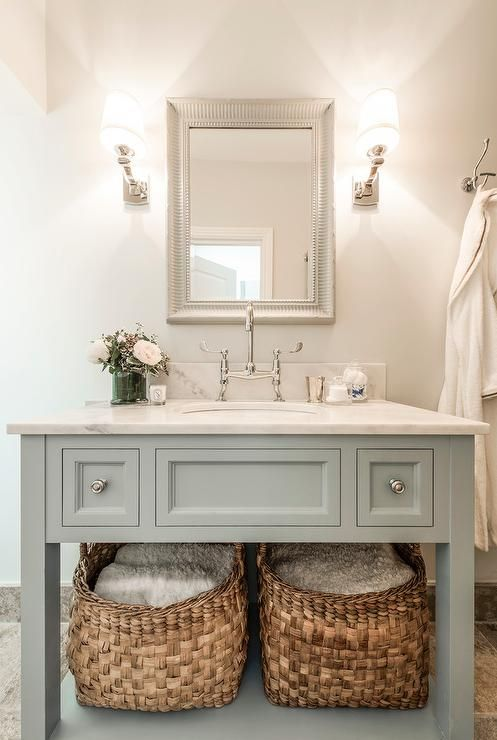 Elegant Bathroom Boasts A Gray Blue Vanity With Shelf