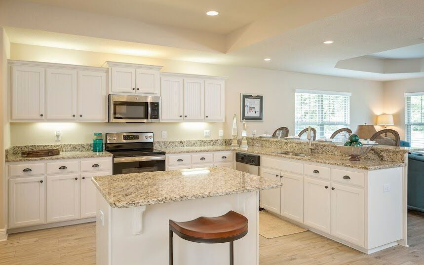 One Of Our Luxurious Kitchens Equipt With Granite Crisp White Cabinets And A Spacious Island Adams Homes New Homes For Sale Kitchen Inspirations