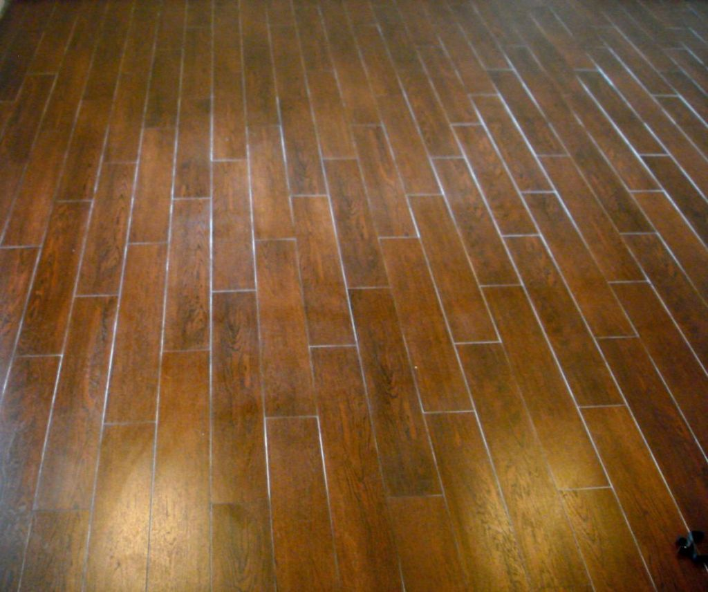 This might be interesting...ceramic tiles that look like wood. All ...