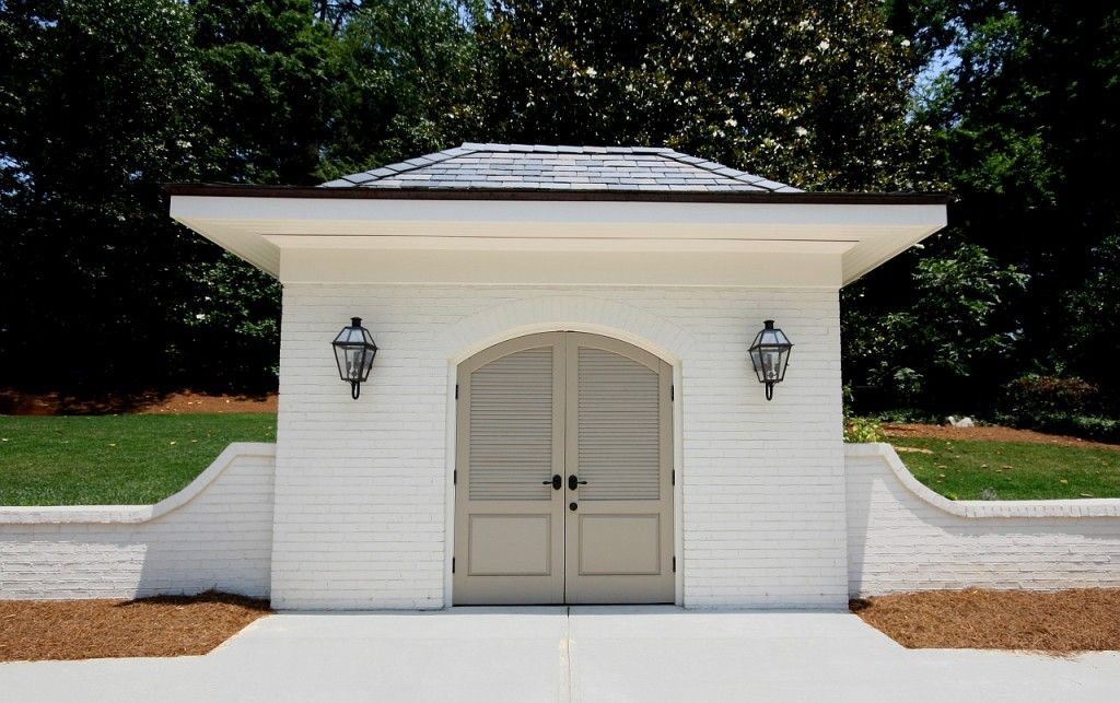Awesome golf cart or storage shed exterior for Golf cart garage door