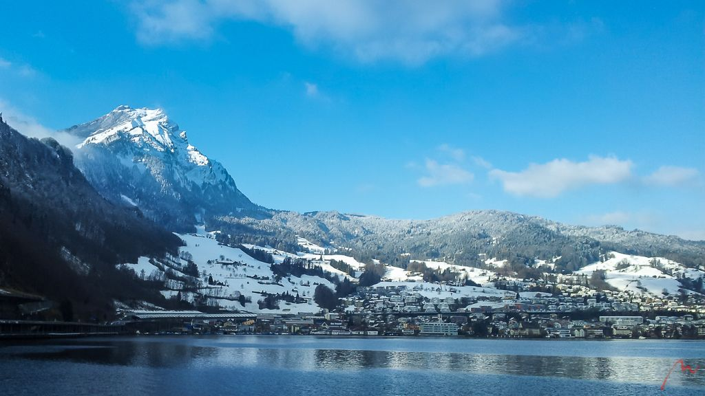 Snowy Mount Pilatus and Hergiswil along Lake Lucerne coming from Stans