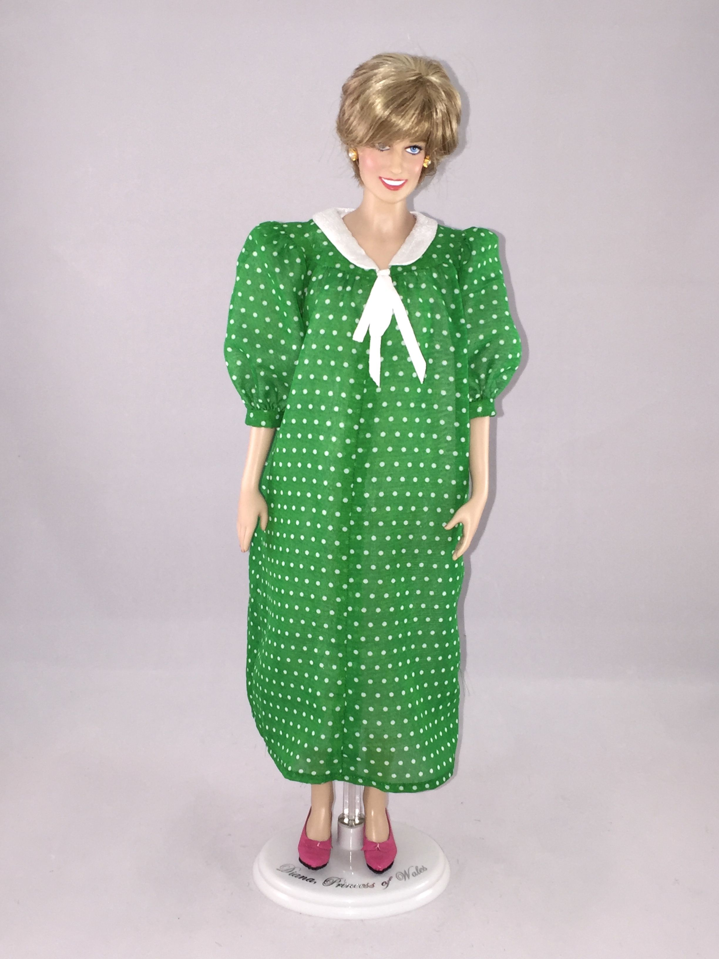 This franklin mint diana doll is wearing a custom replica of the this franklin mint diana doll is wearing a custom replica of the green polka dot maternity dress that princess diana wore as she emerged from the hospital ombrellifo Image collections