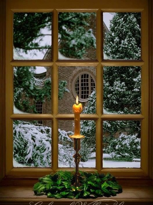 Candle in a winter window
