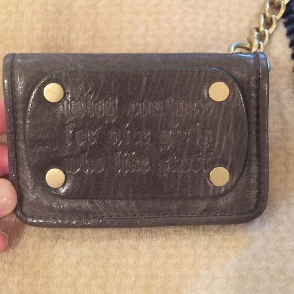 [Juicy Couture] grey leather card holder keychain Super cute grey leather card holder from Juicy.  Old school Juicy Couture.  Has brass hardware and a chunky keychain to attach to your keys if desired.  Features an ID window and 4 spots for cards and cash.  Blue and white lining.  Good condition. Juicy Couture Bags Wallets
