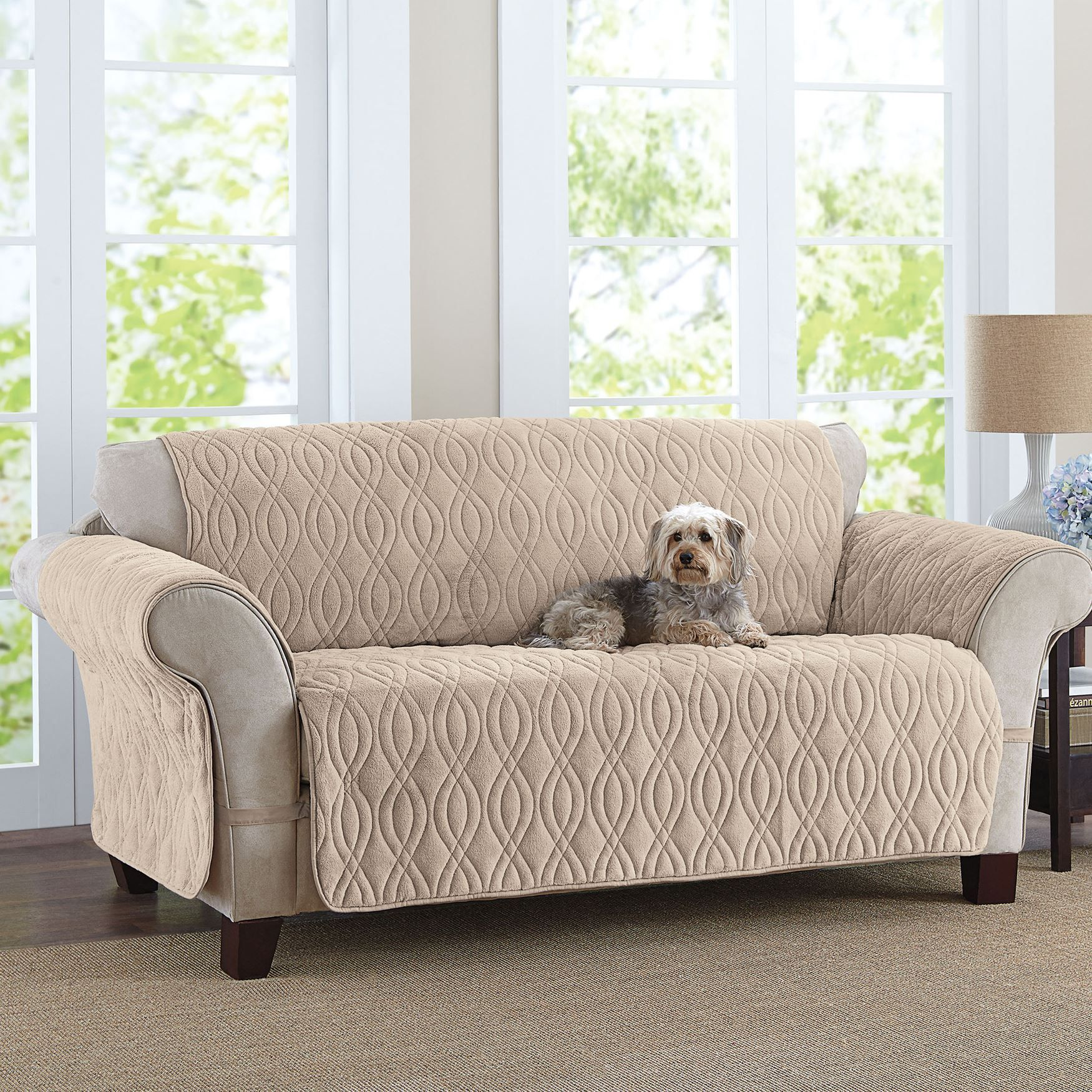 This deluxe quilted fleece like sofa cover is designed to wrap