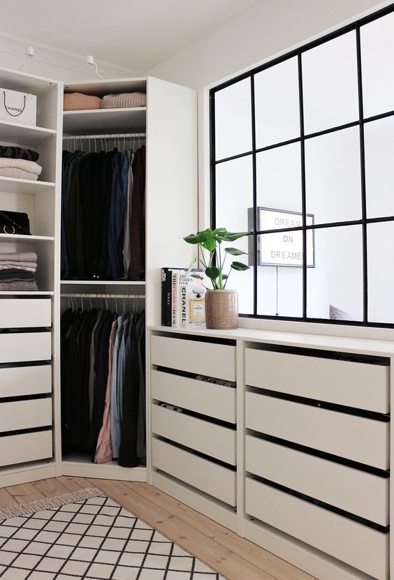 A Comfy Modern Walk In Closet With A Large Window And Cabinets With Drawers Walk In Closet Ikea Home Walk In Closet Design