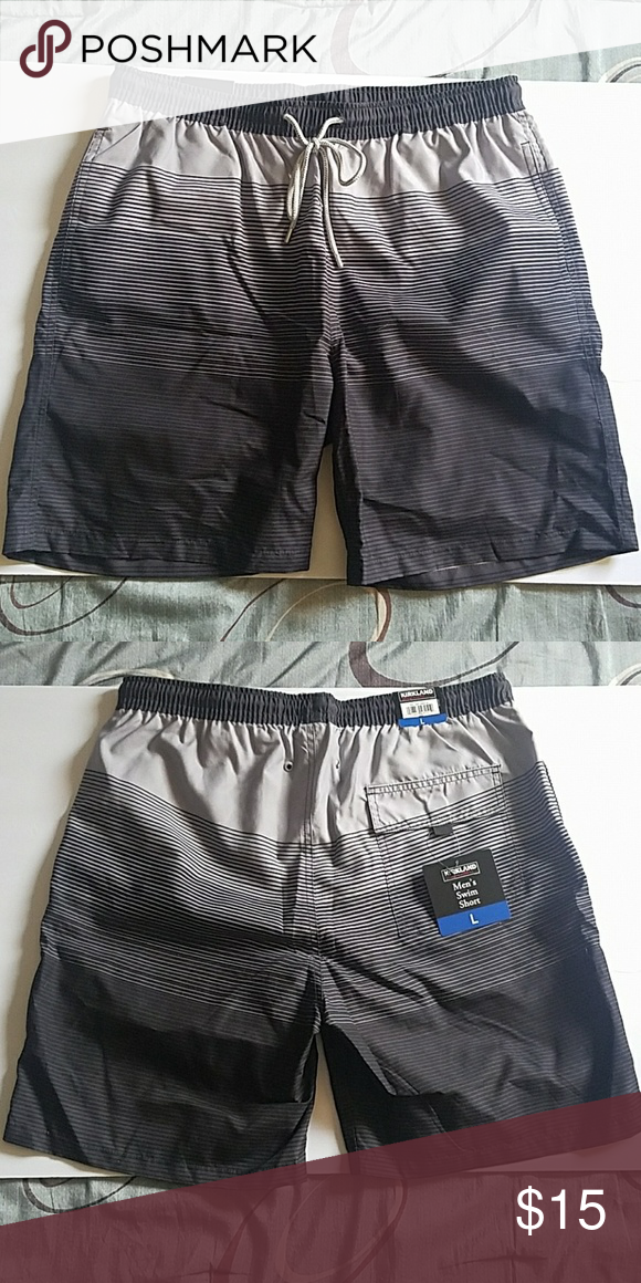bfe5f3011c15c Men's Swim Shorts Men's Kirkland swim shorts in black and silver/gray  colors. Has one back pocket, two side pockets, and strings to tighten. Size  Large.