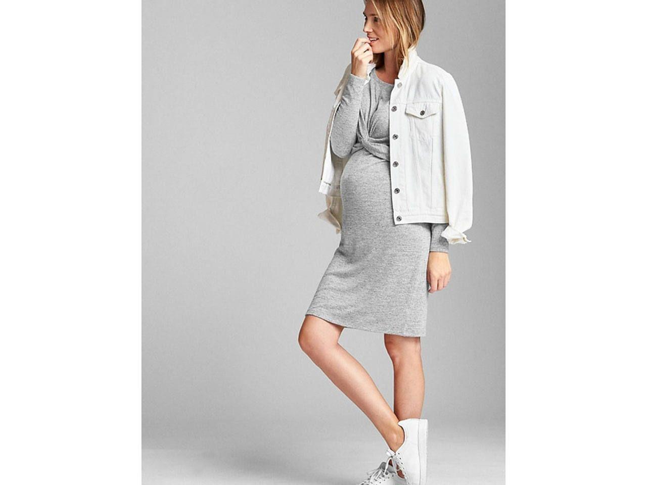 4ba7ab4708d7a A pregnant woman wearing a grey maternity dress and a white denim jacket