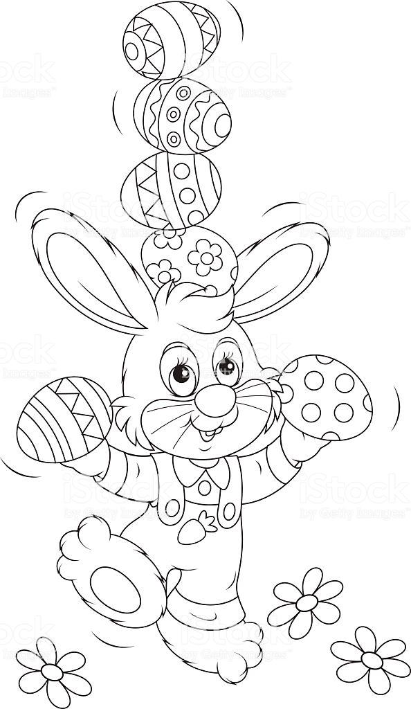 kleines kaninchen das mit ostereiern jongliert