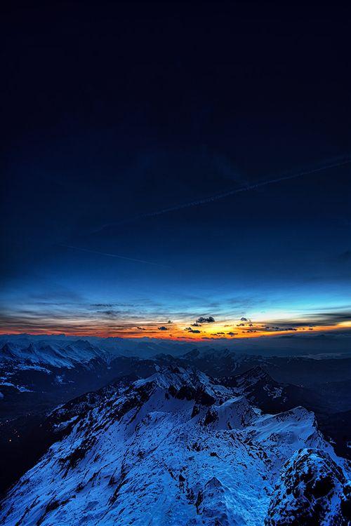 Sunrise  Seen while preparing for moonlight photography on top of Säntis mountain in Switzerland. ByKai Böhm