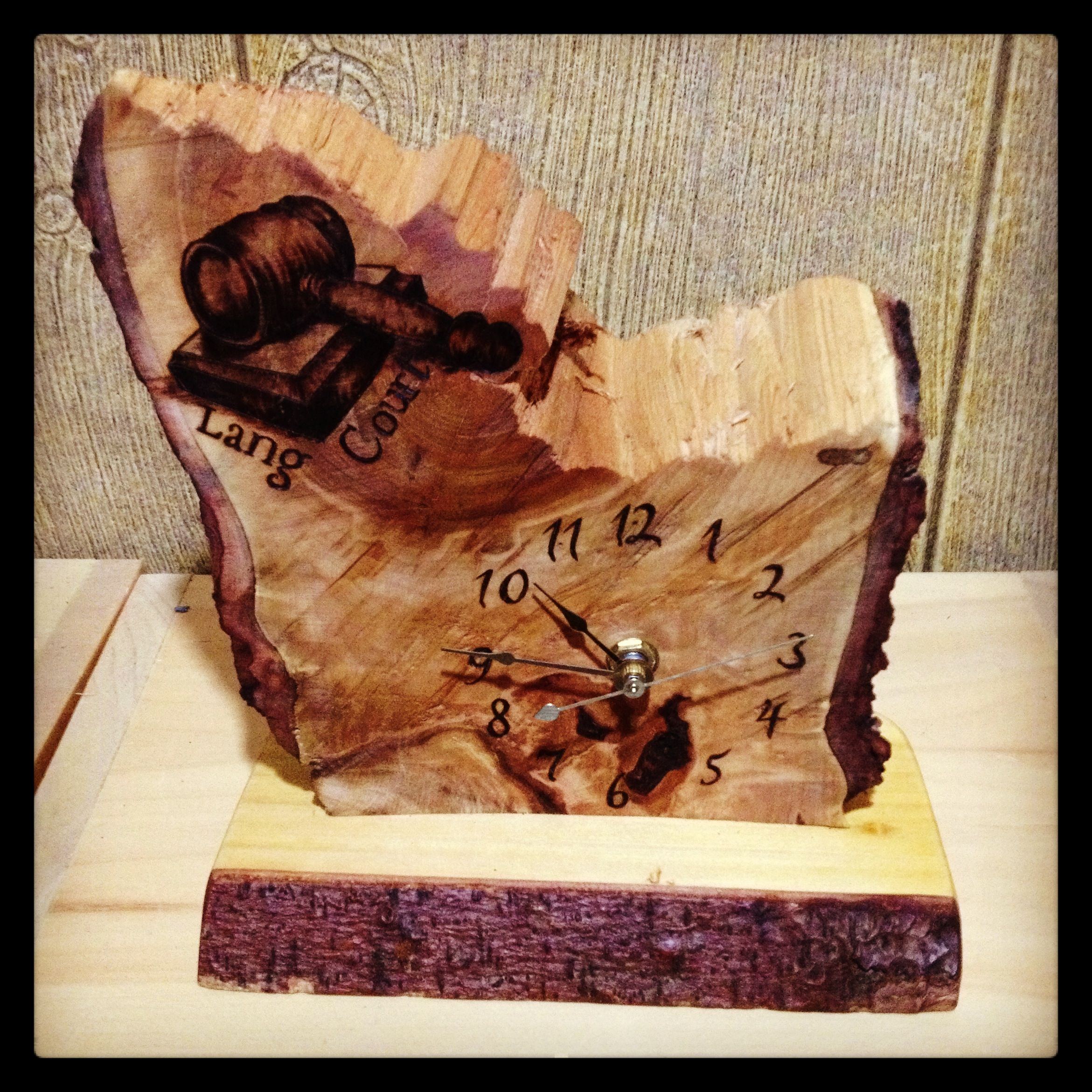 Clock face on reclaimed wood for law office