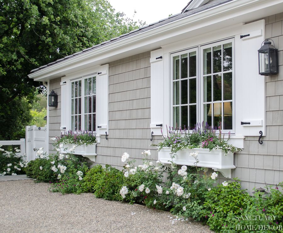 How Window Shutters And Planter Boxes Transformed The Exterior Of My House Cottage Exterior Exterior House Colors Window Shutters Exterior