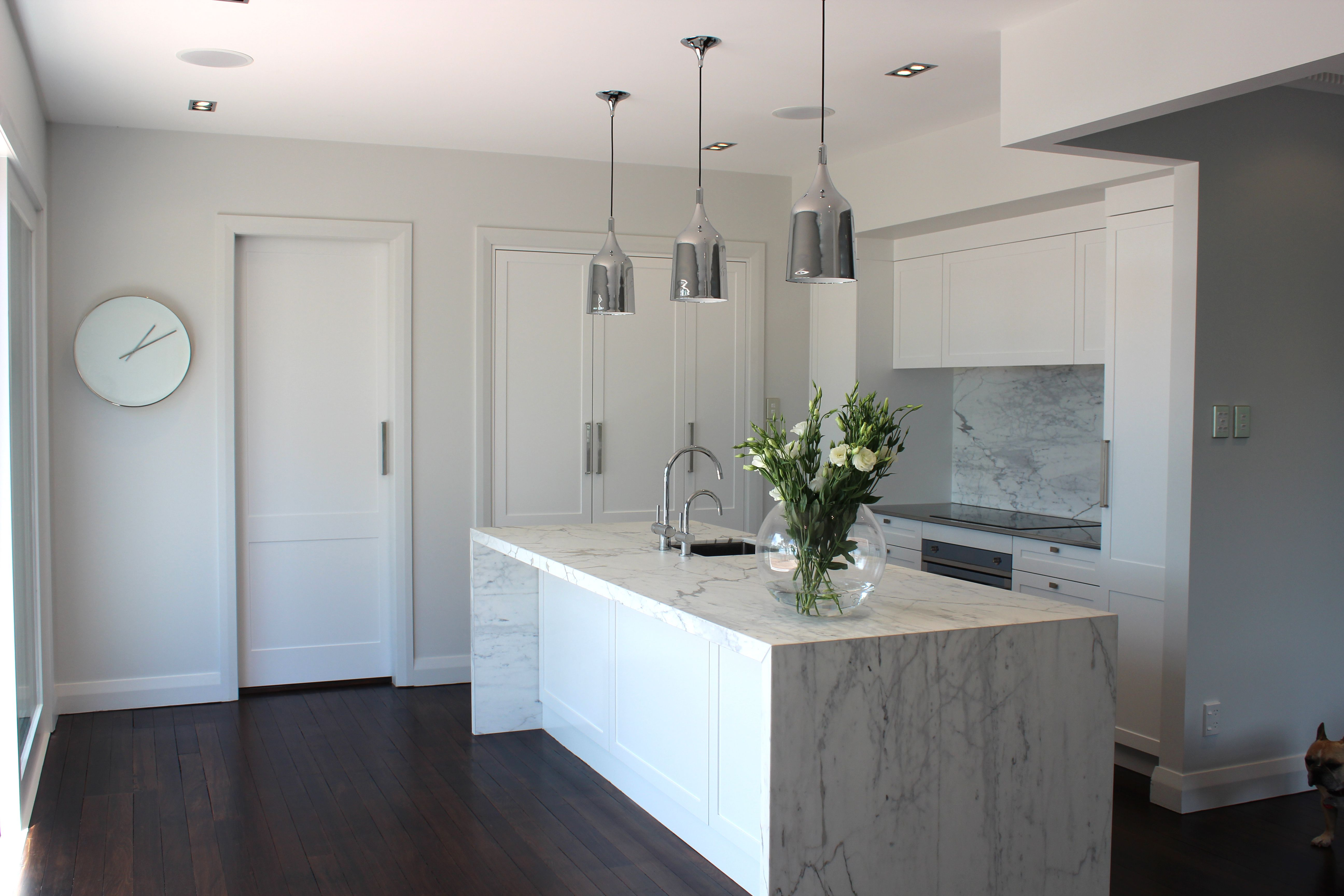 Uncategorized Kitchen With Integrated Appliances my kitchen carrara marble waterfall benchtop and splashback copacabana pendants fully integrated appliances