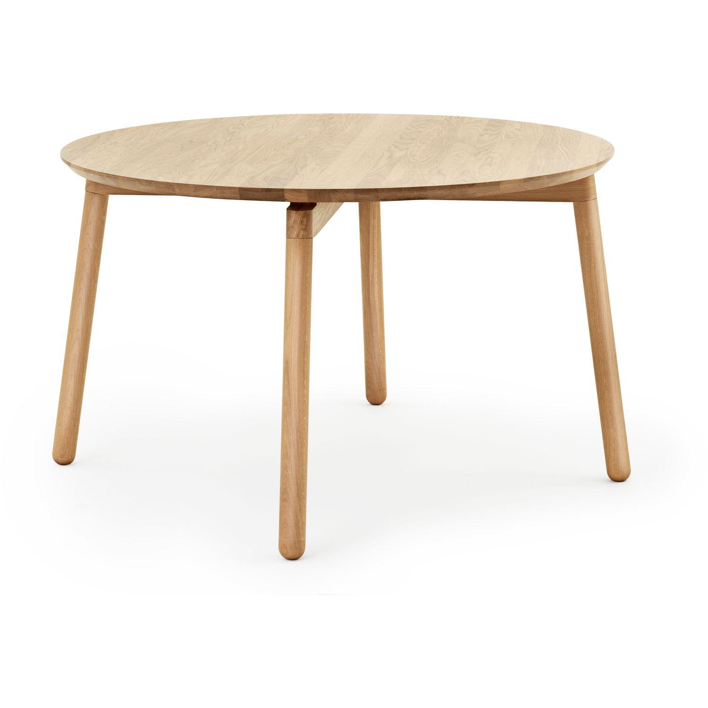 Mesa redonda con cuatro orificios para que pasen tornillos con
