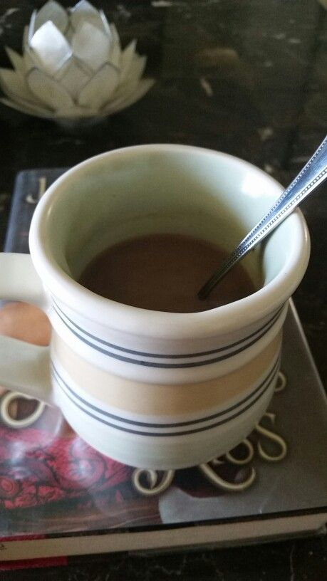 A cup of chai tea, a heaping teaspoon of dark cocoa powder, and a helping of sweet coffee creamer. Success!