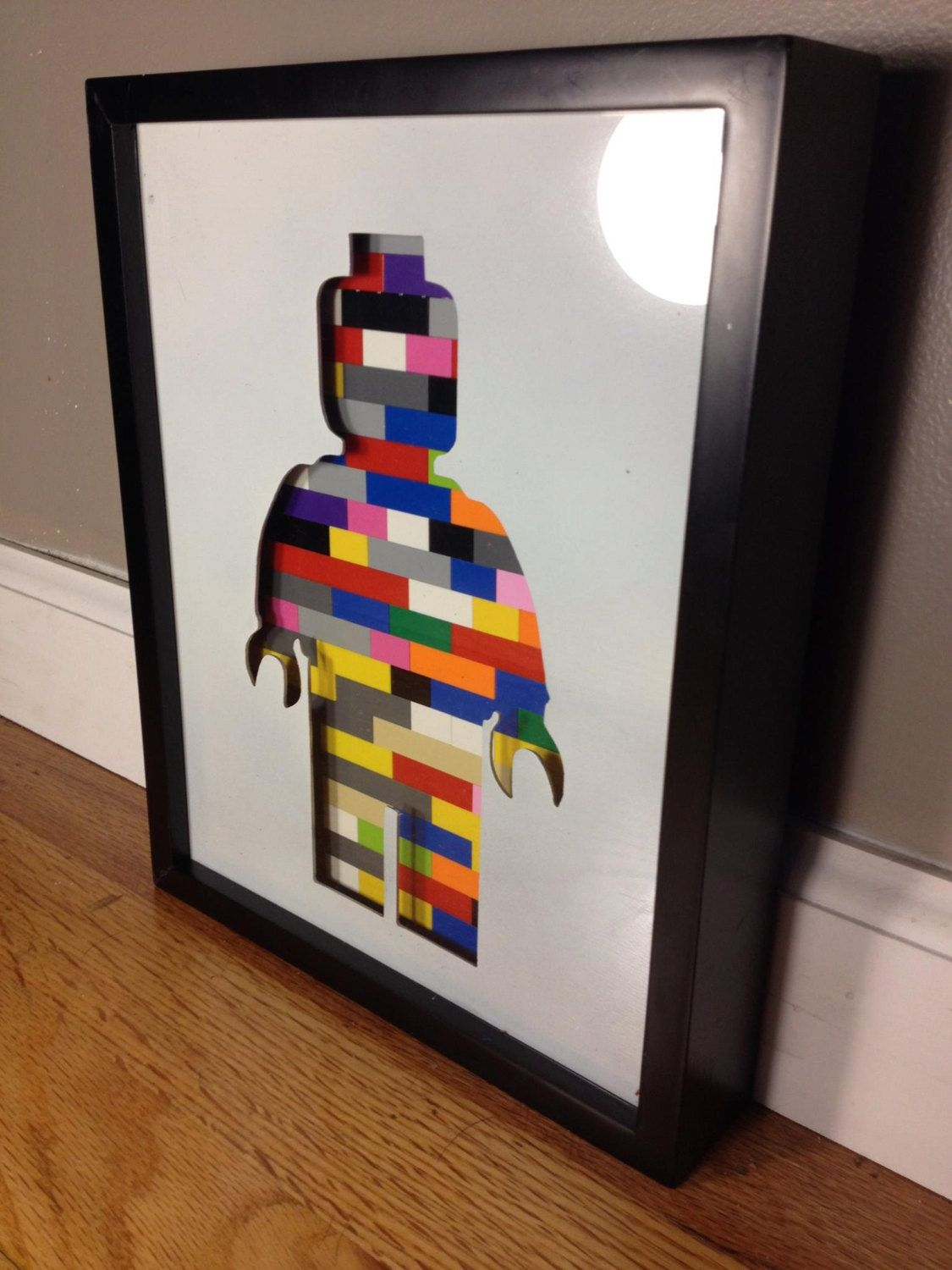 Lego 8 x 10 picture frame Shadow box with a metal insert of a LEGO ® minifig silhouette cutout with multicolored blocks behind & Lego 8 x 10 picture frame: Shadow box with a metal insert of a ... Aboutintivar.Com