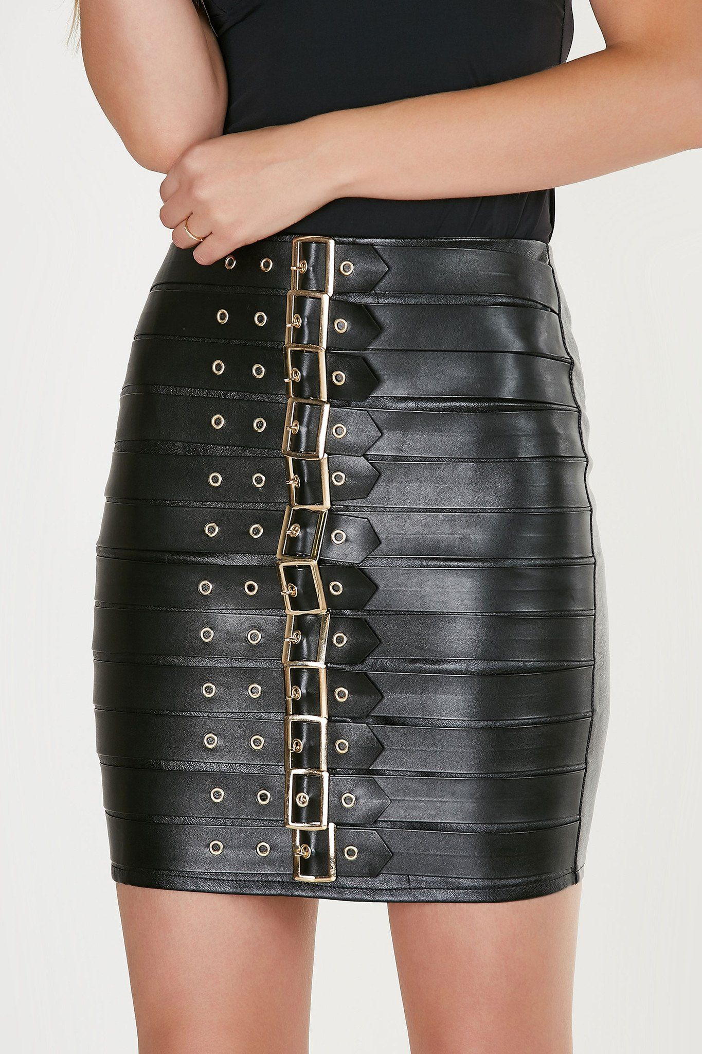 c95ab2b516 Sexy high rise mini skirt with faux leather finish. Bold belted design with  gold hardware finish and back zip closure.