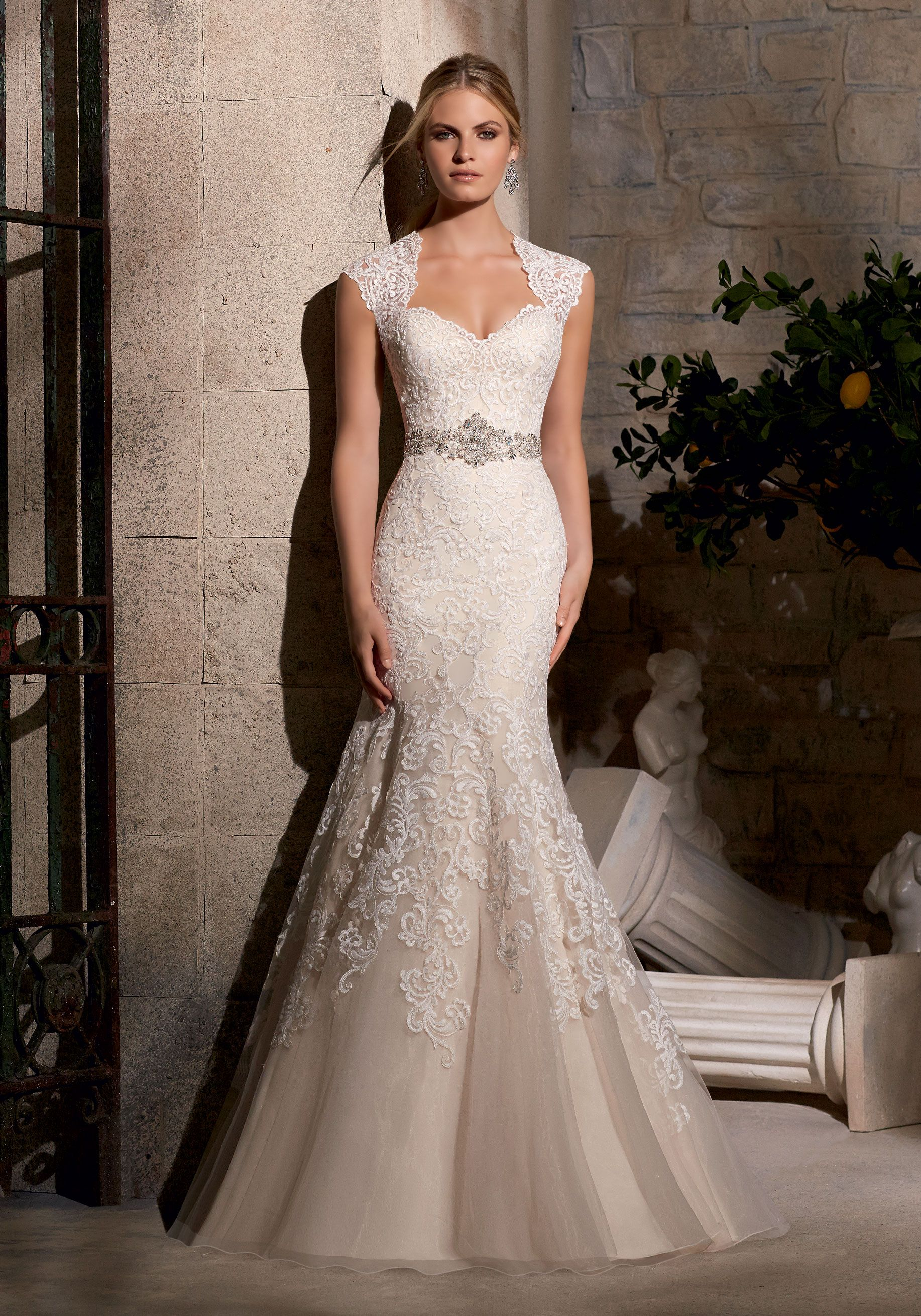 Beaded sheath wedding dress  Ornate embroidery adorns this Bridal Dress Diamante beading creates
