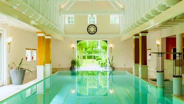 luxury homes with phenomenal swimming pools an indoor pool on the property of a luxury - Luxury Homes With Indoor Pools