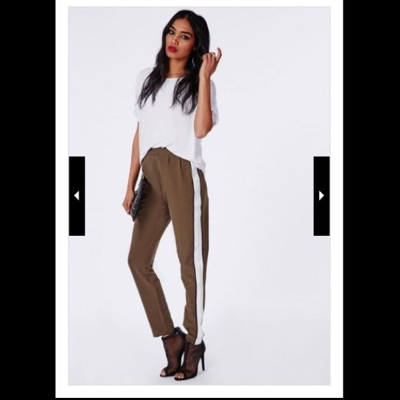 Express White Cigarette Trousers Sleek white and black stretch trouser pants with elastic waist band and a tapered leg. Ankle length go nicely with heels, a sexy shirt and blazer. Never worn only tried on. Smoke free home. Express Pants Trousers