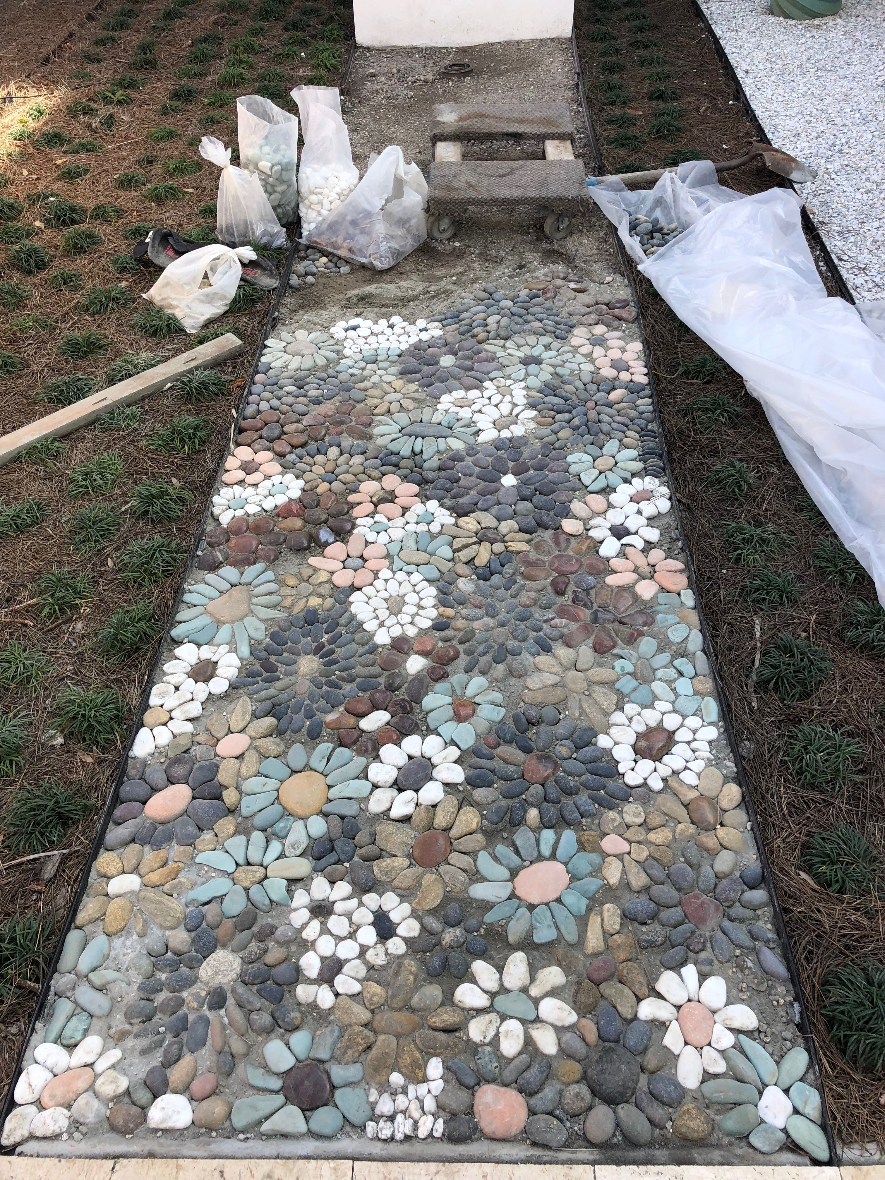 My Pebble Mosaic I Still Have 6 Feet To Go It Takes About An Hour Per Square Foot Rocks Are Set In Dry Mix Walkway Landscaping Garden Walkway Garden Paths