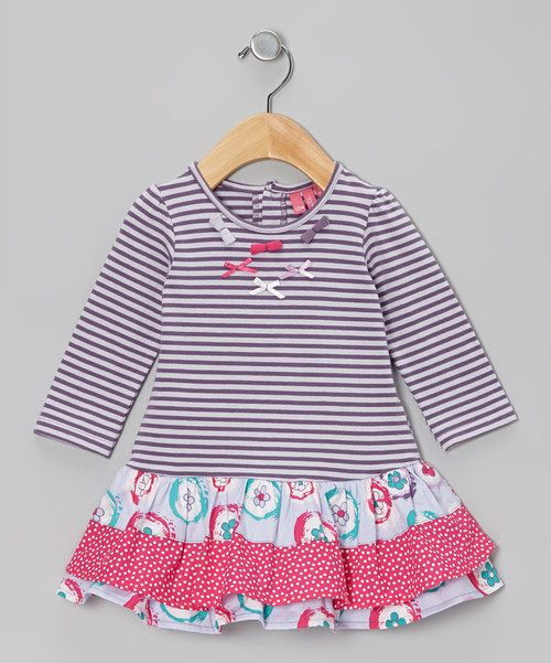 The prints and bitty bows on this dress are just as charming as the little girl wearing them. Stretchy cotton, easy care instructions and back snaps earn it three cheers for kid-friendly convenience.95% cotton / 5% elastaneMachine washImported