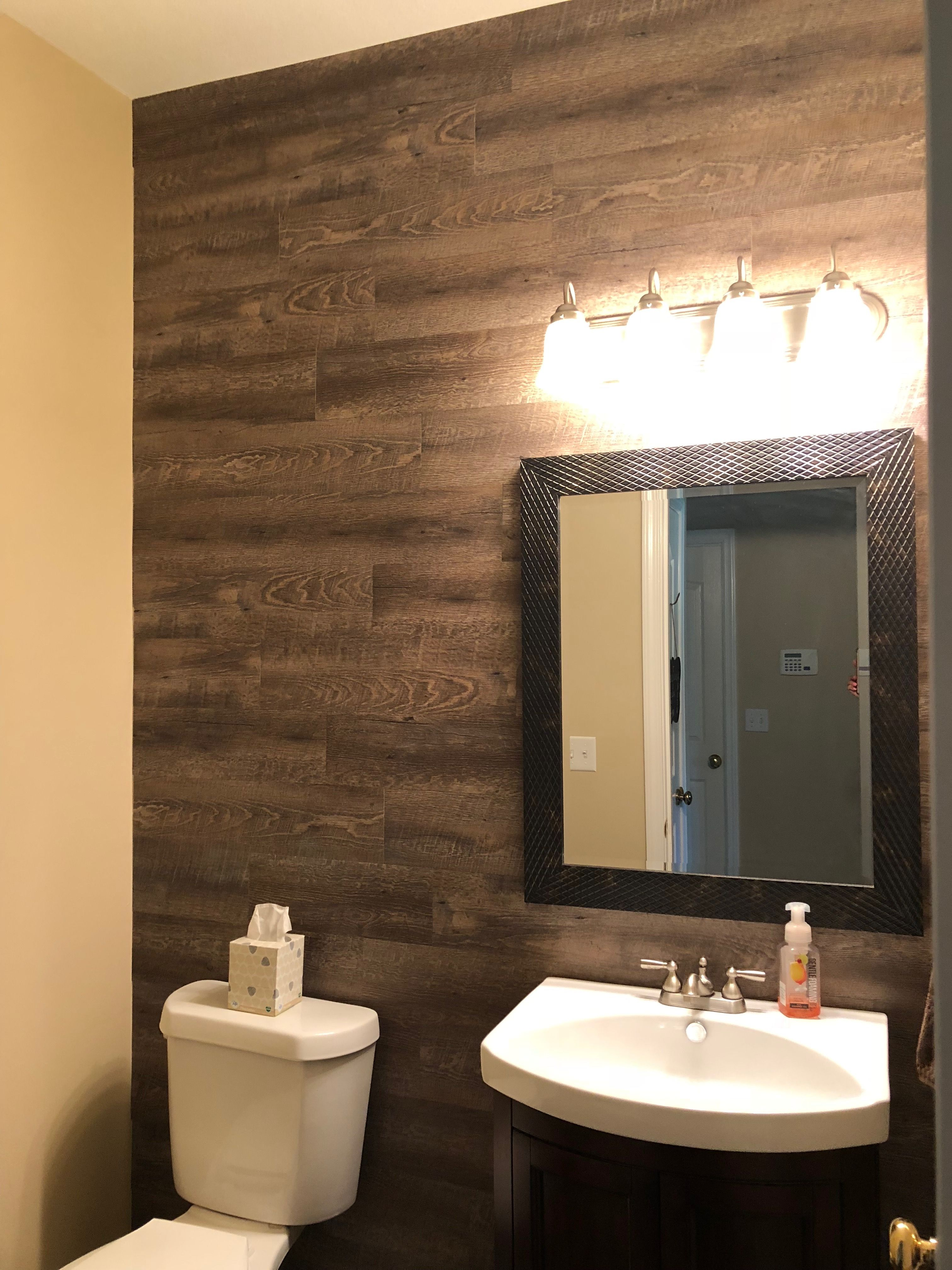 Vinyl Plank Wood Wall Using Peel And Stick Fromlowe S Wood Wall Bathroom Plank Wall Bathroom Bathroom Remodel Small Budget