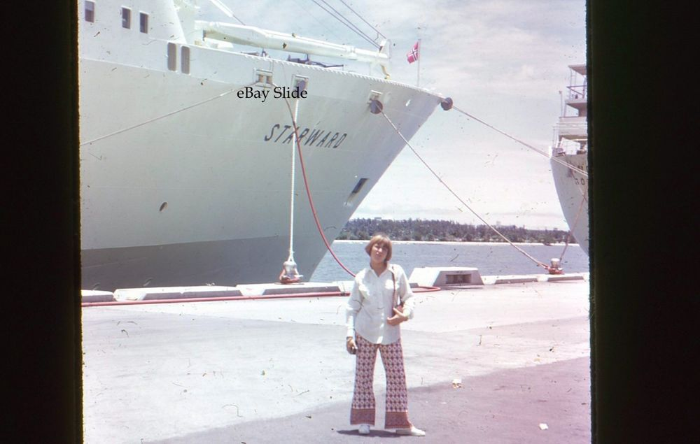 Starward Mm Slide Cruise Ship Docked Girl Wearing Bell - Starward cruise ship