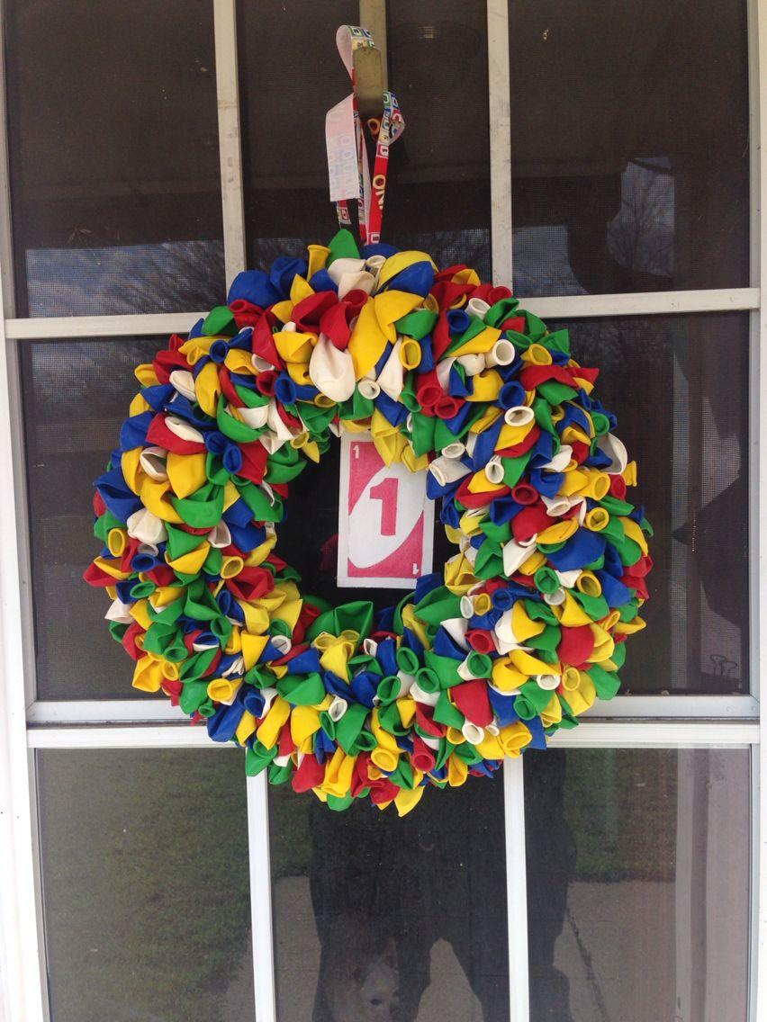 Uno balloon wreath with wooden uno card. Evans first birthday