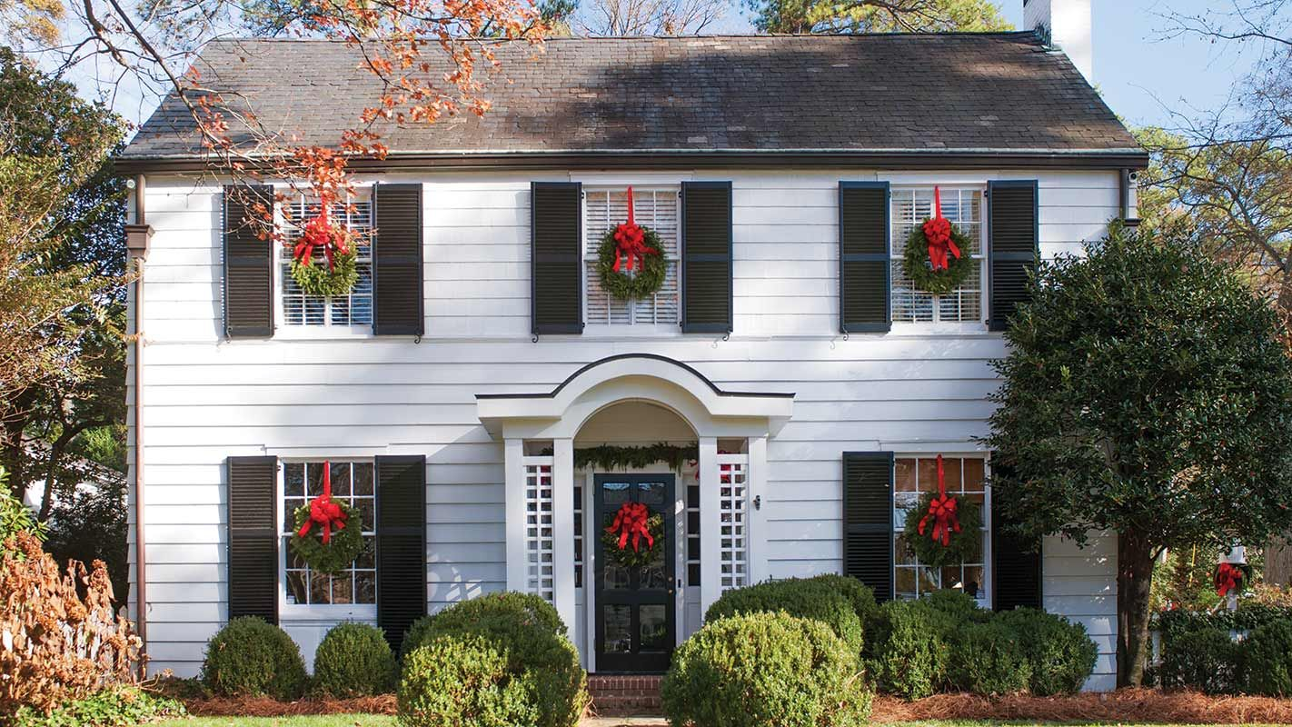This Festive Colonial Revival Has A Stunning Shiplap Clad Bar Southern Home Magazine Colonial House Exteriors House And Home Magazine Colonial Revival