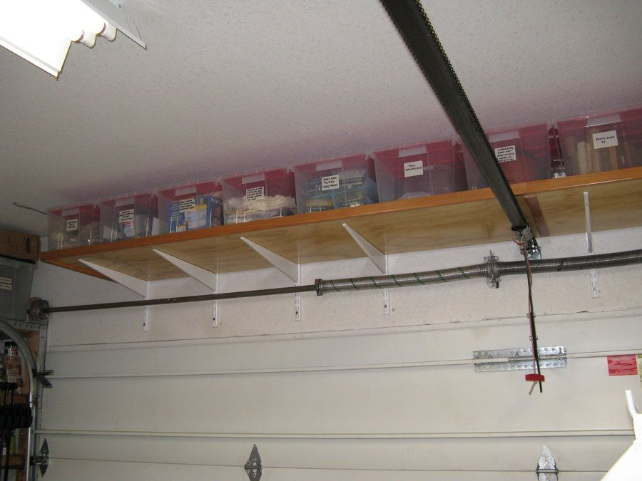 Over garage door storage ideas pinteres for Over car garage storage