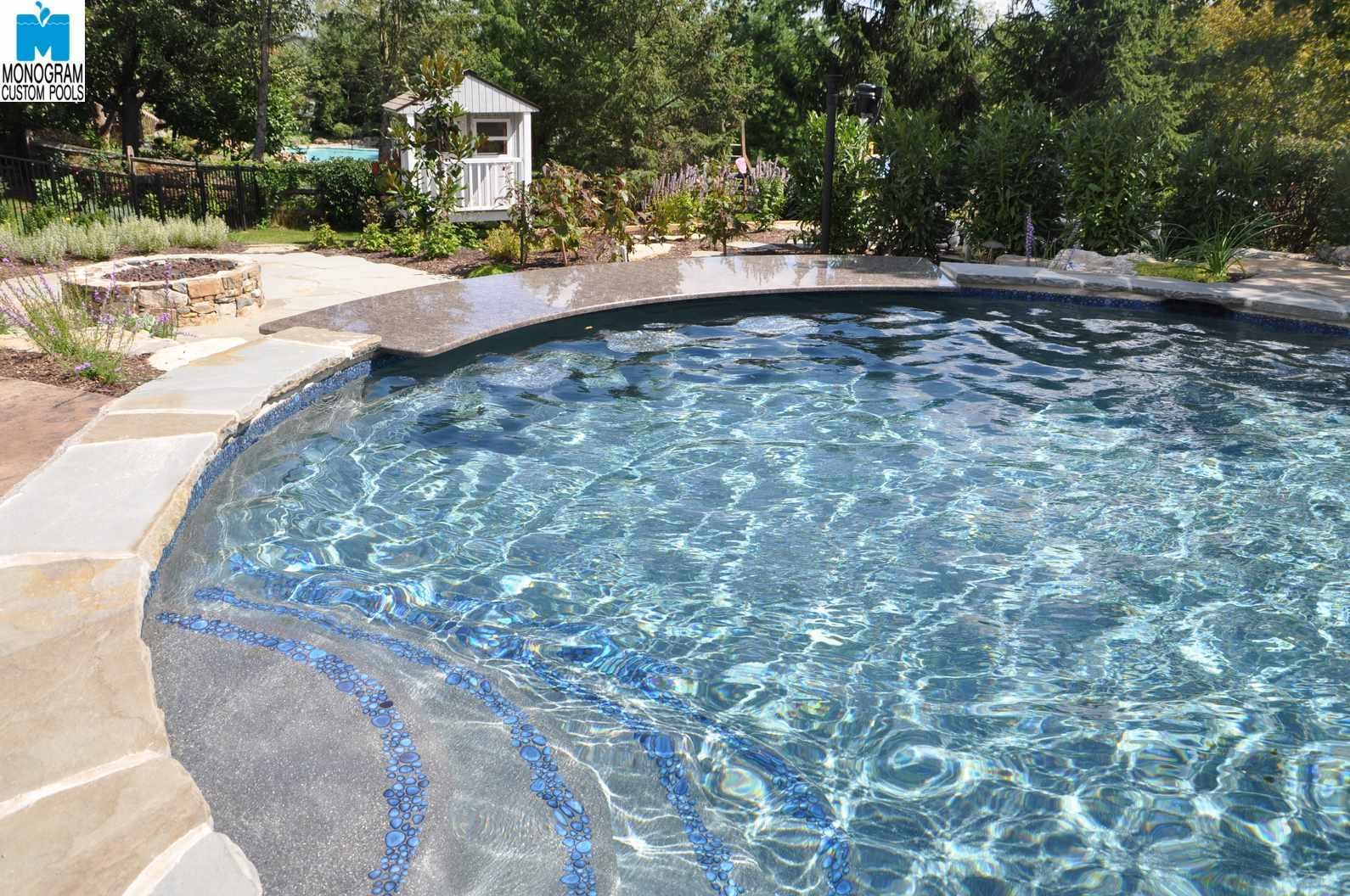 Swim up bar by monogram custom pools custom pool ideas for Custom pool designs