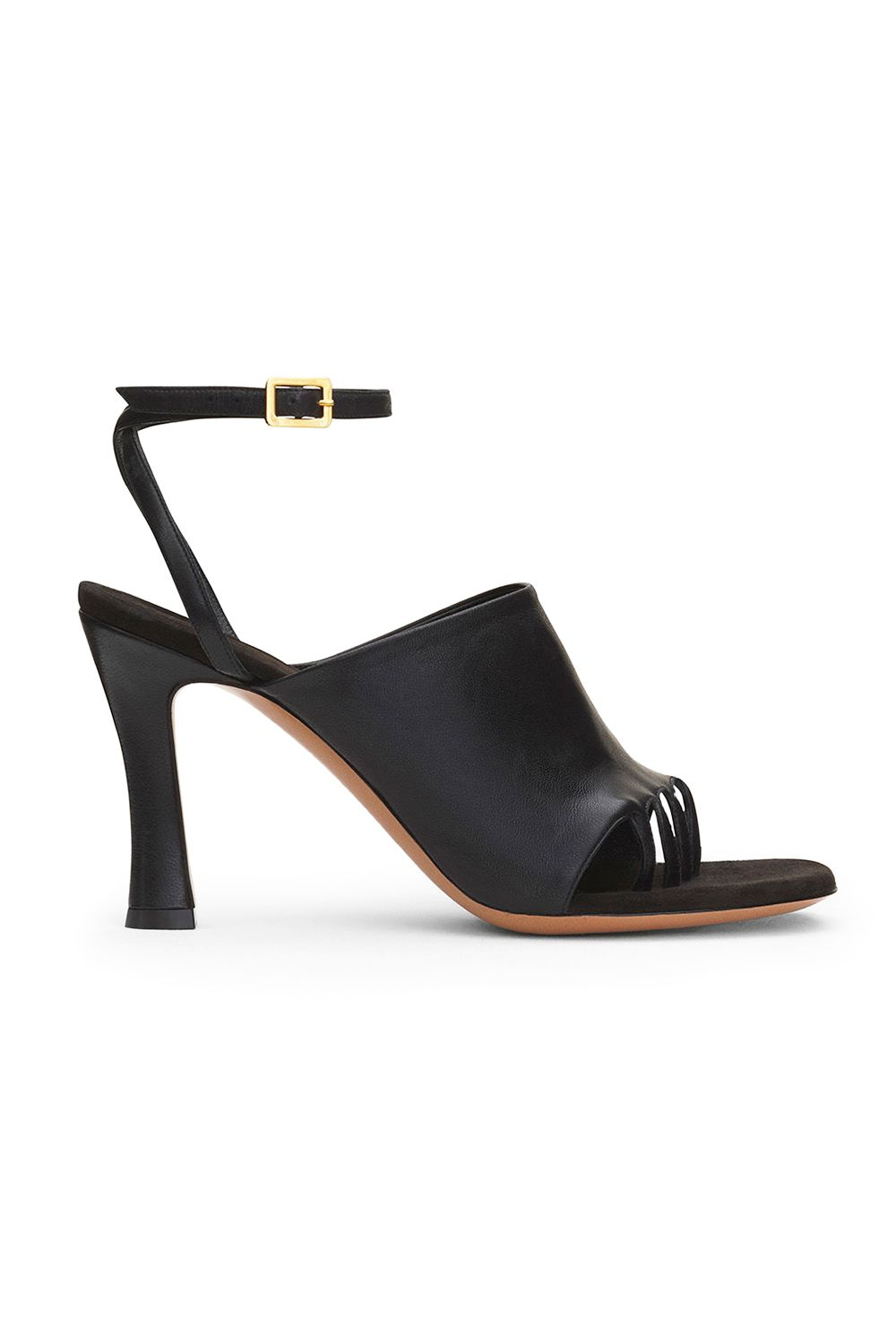ebc0577aa1e The Celine Glove Heel is a round and wide toe sandal with a construction  that holds