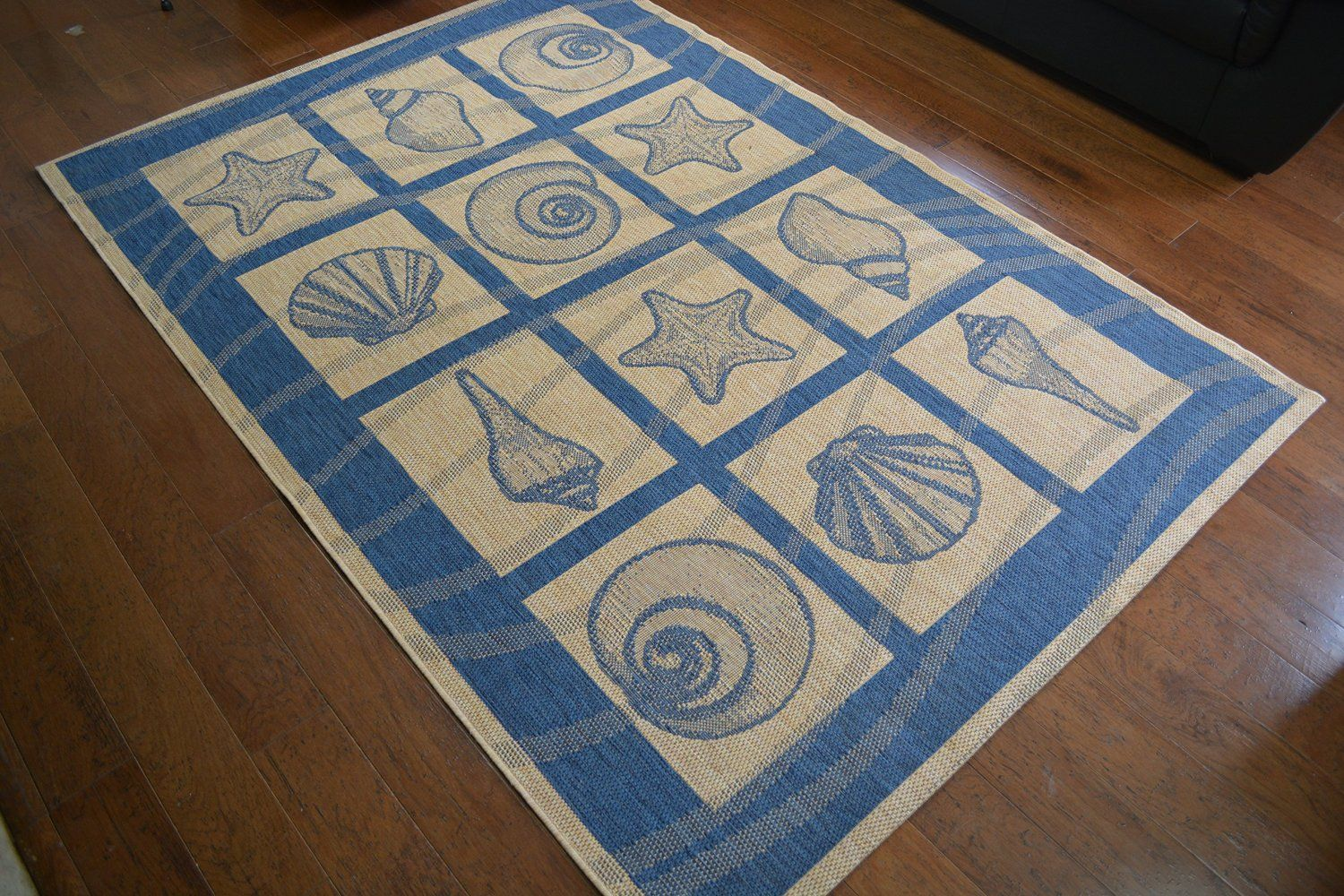 Coastal Seashell Indoor/Outdoor Blue Ivory Area Rug.  Perfect for your coastal or beach home.