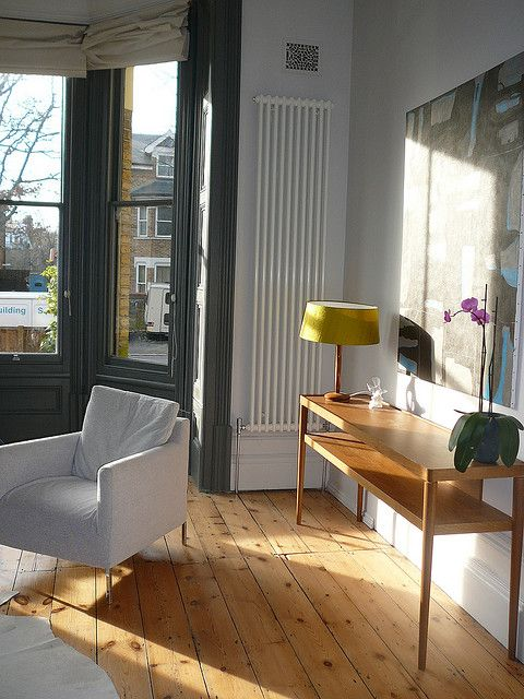 Designer Living Room Radiators: Downpipe Window Panelling And Console Table