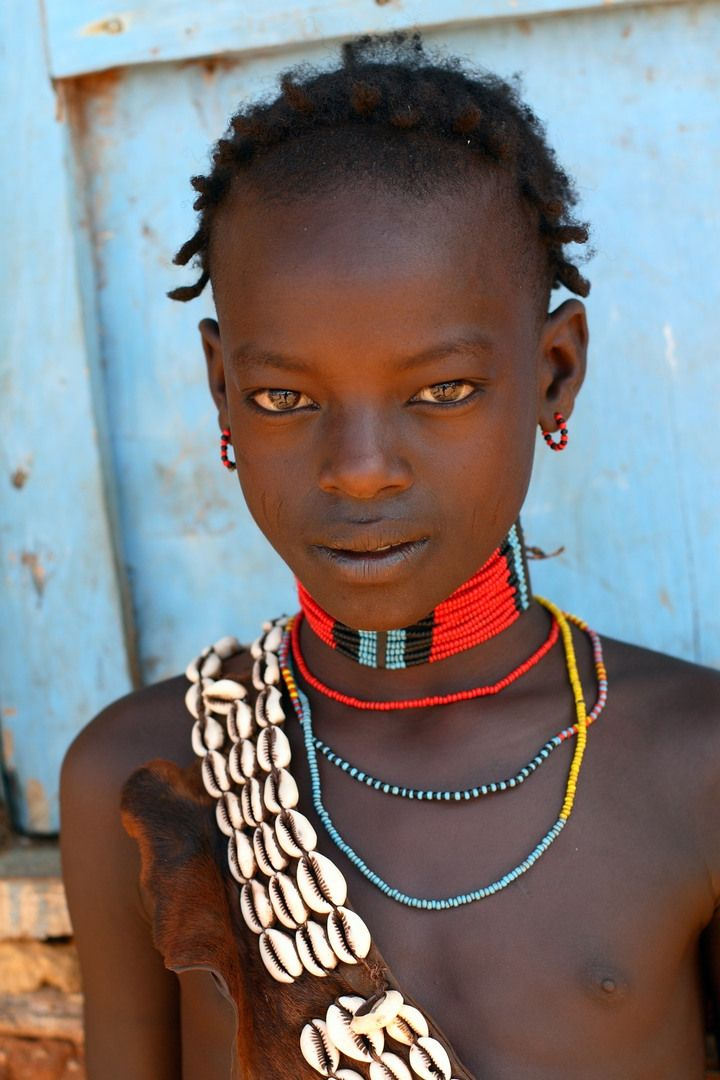 Child with necklace.  Google Image Result for http://i.images.cdn.fotopedia.com/flickr-3201451573-hd/People_around_the_World/Africa/Ethiopia/Faces_of_Ethiopia.jpg