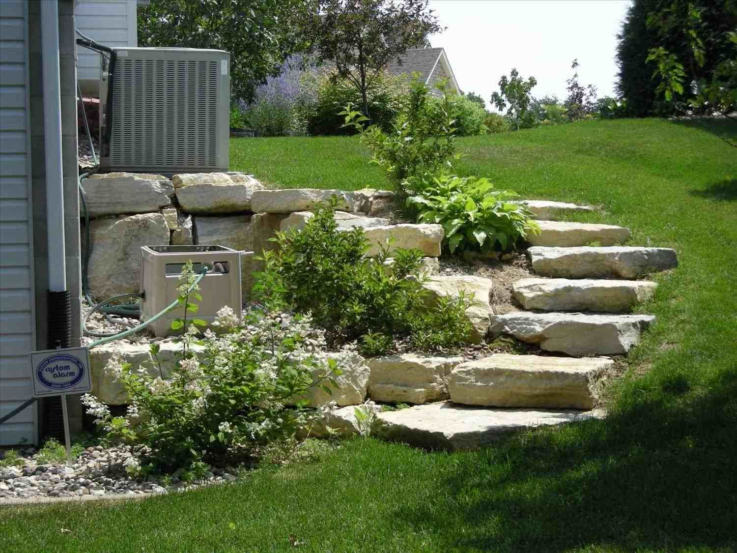 Top 15 Adorable Landscaping On A Slope Backyard On Your ... on Small Sloped Backyard Ideas On A Budget  id=11421