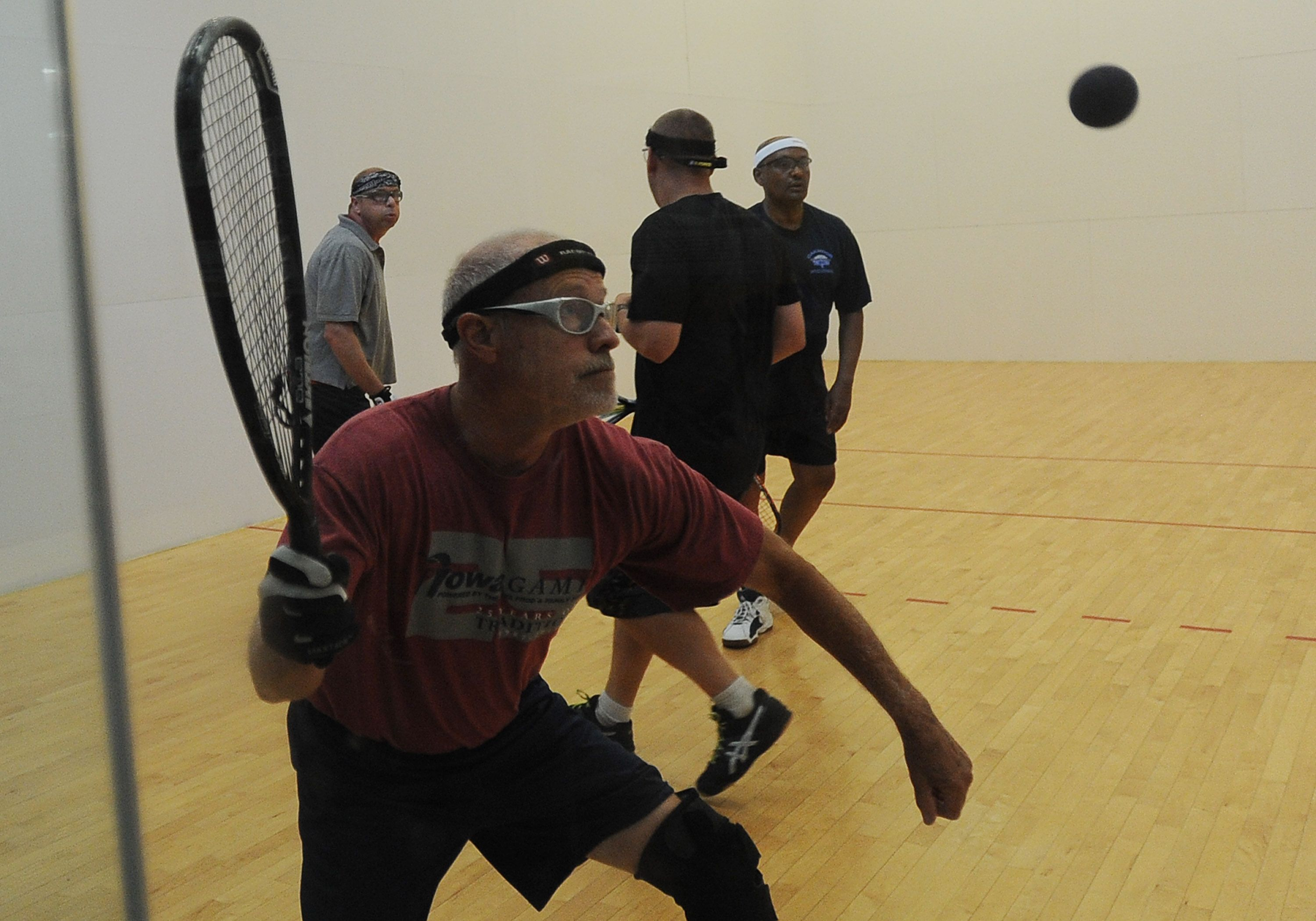 Ron Sweeney returns the ball during the racquetball double
