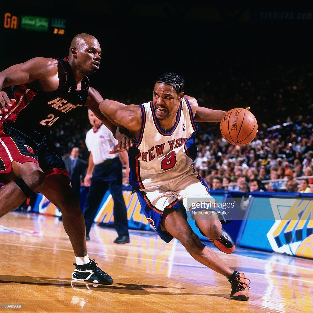 df5c193a9624 Latrell Sprewell  8 of the New York Knicks drives to the basket against  Jamal Mashburn  24 of the Miami Heat in Game Four of the Eastern Conference  ...
