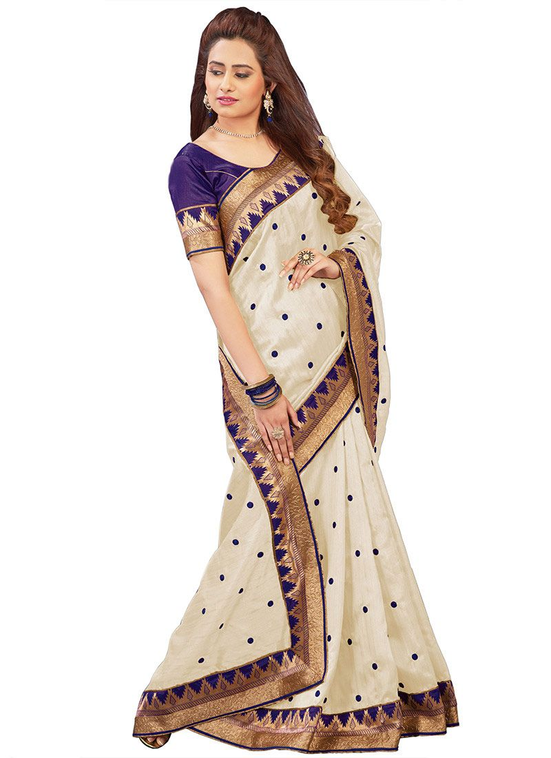 Latest cream art indian clothes and silk sarees