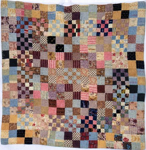 Squares Cot Quilt, 1850-1890. Made by Mary Dennis-Cann or daughter. The Quilters' Guild Collection